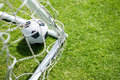 High angle view of soccer ball by goal post Royalty Free Stock Photo