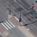 High angle view of a street intersection an empty with cross walk markings traffic signal lights Royalty Free Stock Image