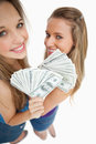 High-angle view of two young woman holding dollars Royalty Free Stock Images