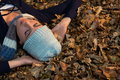 High angle view of woman lying on dry leaves Royalty Free Stock Photo