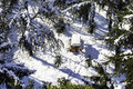 High angle view of wooden picnic table and trees covered by snow in a forest on winter day Royalty Free Stock Photo