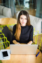 High angle view of an young brunette working at her office desk with laptop. Businesswoman working in office Royalty Free Stock Photo