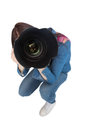 High angle view of young photographer taking picture of camera against white background Stock Image