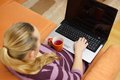 High angle view of young woman using her laptop in living room Royalty Free Stock Photo