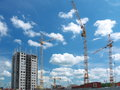 High building under construction with cranes the modern on a blue sky background Royalty Free Stock Photos