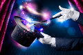 High contrast image of magician hand with magic wand and hat Stock Images
