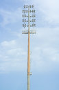 High electric floodlight pole in stadium with sky and daylight Royalty Free Stock Photo