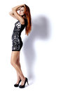 High fashion lady glamour full length of a fashionable beautiful redhead woman over white background Royalty Free Stock Photo