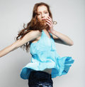High fashion model jumps in studio this image has attached release Royalty Free Stock Photography