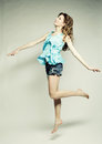 High fashion model jumps in studio this image has attached release Royalty Free Stock Photos