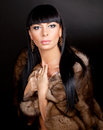 High fashion model wearing  fur vest Stock Images