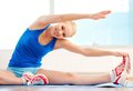 High flexibility smiling woman with body exercising in the gym Royalty Free Stock Photography