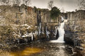High force waterfall in winter with the river tees plunging metres below Royalty Free Stock Photos