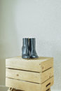 High heel boots on wooden box in walk in closet Royalty Free Stock Photo