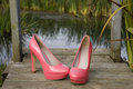 High heel shoes heels at the lake Royalty Free Stock Image