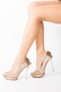High heel shoes woman legs in golden studio shot Stock Photography