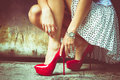 High heel shoes woman legs in red and short skirt outdoor shot against old metal door Stock Photos