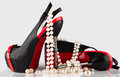 High heeled shoes and a pearl necklace women s Royalty Free Stock Photography