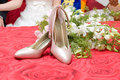 High heels and flowers Stock Photos