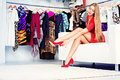 High heels shoes fashionable girl choosing in a store Stock Image