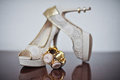 High heels wedding shoes and bracelet on table. Wedding accessories Royalty Free Stock Photo