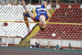 High jump athlete male performing during discipline at romanian international atheltics championship stefan cel mare stadium Stock Photos