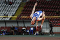 High jump athlete male performing during discipline at romanian international atheltics championship stefan cel mare stadium Stock Image