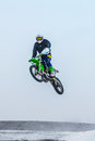 High jump athlete on a motorcycle Royalty Free Stock Photo