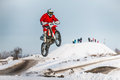 High jump and flight of motorcycle racer Royalty Free Stock Photo