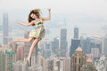 High jump over cityscape young fashion model jumping against view Stock Images