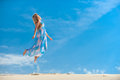 High jump young woman jumps on the background of blue sky Stock Images