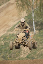 High jumping quad racer. Vertically. Royalty Free Stock Photo