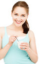 High key portrait young caucasian woman eating yogurt isolated smiling Stock Image