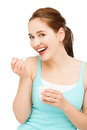 High key portrait young caucasian woman eating yogurt isolated smiling Stock Images