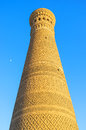The high minaret great decorated with patterns made of bricks bukhara uzbekistan Stock Photos