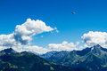 High mountains landscape with hang glider in soaring flight. Austria, Tirol, Zillertal Royalty Free Stock Photo