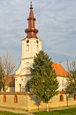 High noon on church tower clock north serbia Stock Photos