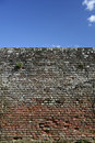 High Old brick wall blue sky background Royalty Free Stock Photo