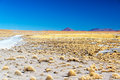 High plains and volcanoes in uyuni bolivia with in the background Royalty Free Stock Image