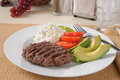 High protein diet meal a low carb with a grilled sirloin patty and avocado Stock Images