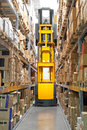 High rack stacker forklift truck in warehouse rows Stock Photography