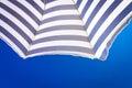 High resolution beach umbrella on blue sky background Royalty Free Stock Photo
