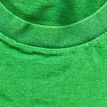High resolution close up of bright green cotton fabric with part of a shirt s collar crossing Royalty Free Stock Images