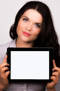 A high resolution image of a beautiful young female using an ipad tablet device Royalty Free Stock Photos