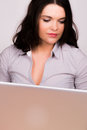 Beautiful young female using a laptop computer Royalty Free Stock Photo