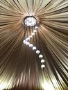 Picture : Decorated tent with bulb garland. Wedding setup white paper lanterns inside of building, under cloth roof decoration.  oak
