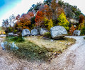 High resolution panorama at lost maples texas panoramic view of a crystal stream and granite boulders surrounded with fall foliage Stock Image