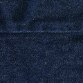 High resolution scan of dark blue denim fabric with a horizontal seam crossing Stock Photo