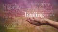 High resonance healing words healer s outstretched open hand surrounded by random wise on a rustic stone effect background Royalty Free Stock Photos