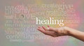 High resonance healing words on pastel background healer s outstretched open hand surrounded by random wise a pale rustic stone Stock Photography